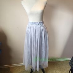 "Gray 2 Layer Tulle Skirt Fashionable tulle skirt. 2 layers of tulle with lining. More slim shape than the 5 layers skirts, see other listings. Waist unstretched measures about 10.5"", stretched to about 16""  30"" in Length. Never worn.  No Trades. Skirts"