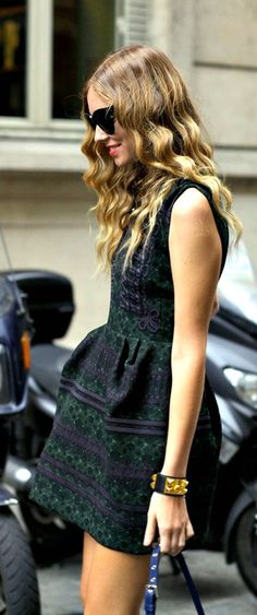 dark pattern, heavier fabric dress with black and gold bracelet and dark sunglasses of course!