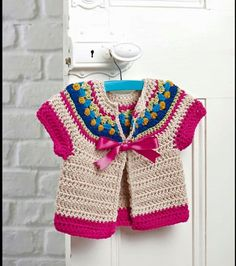 Simply crochet issue 2016 by Camelia July - issuu Very Cute Baby Girl Knit Vest Models - Home Arragement - Newborn baby and newborn clothing, including party clothes, sleepsuits, vests and outdoor adventure dress. This Pin was discovered by Gül crochet p Cardigan Au Crochet, Cardigan Bebe, Crochet Baby Sweaters, Crochet Baby Clothes, Crochet Girls, Crochet For Kids, Knit Crochet, Knit Vest, Baby Cardigan