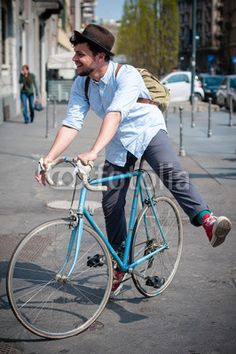 hipster young man on bike $1