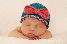 (Great inspiration-- love the idea of the trim in a verigated yarn, and the bow done in a complementary color featured in the verigated. So cute!)   Colorful newborn baby girl beanie. Bow-tie hat crochet pattern for chunky yarn NOT free pattern.