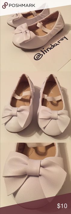 Toddler Girls Cat & Jack Ballerina Flats Toddler Girls Cat & Jack Ballerina Flats. With Bow.  Worn twice so like new condition.  No scratches or nice.  EUC, no signs of wear other than the bottom of the shoe.   Super cute! Cat & Jack Shoes Dress Shoes