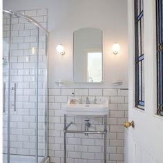 White tiled shower room | Bathroom | Ideal Home | Housetohome