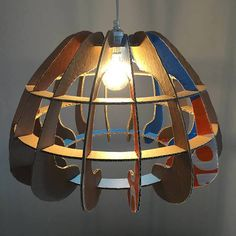 Gilbert de Rooij took a discarded box and upcycled it into a cardboard lampshade called BoxCrown with great print from the original box.