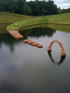 Cells of Life by Charles Jencks. Eight landforms and a connecting causeway surround four lakes at Jupiter Artland in Edinburgh