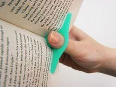 omg! it holds your book open while you read it! i want this. (for when i'm not using my kindle of course!)