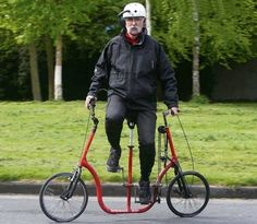 GET ON YER BIKE: Michael Killeen demonstrates how his experimental 'sideways' bike operates and, inset left, Gordon Birch with his electric bike