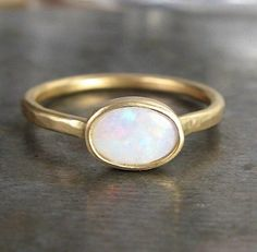 i love the simplicity of this opal ring... my kind of jewelry