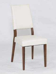 Dining Chair Comprising a solid American black Walnut frame with a sumptuous white faux leather seat pad and back.  Chair Dimensions:  W435mm x D585mm x H975mm Extra chairs available in boxes of 2.
