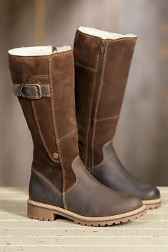 """The Hailey Tall Boots are fashioned in a 12 1/2"""" shaft of oil suede cow leather that's silicone tanned to repel water. Merino sheepskin wool lines the inside for unmatched insulation. Made in Portugal."""