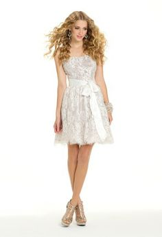 An all lace cocktail dress is a great choice for so many formal events! You can wear it for the holidays, as a guest of wedding dress, prom dress, or even as a short summer dress, the possibilities are endless! As soon as you slip on this short outfit of the night you will look like an effortless beauty, ready for the time of her life! The gorgeous details of this design are: a strapless sequin-lace bodice, a lace edged full party skirt, and a gorgeous ribbon belt tied at the waist to show off …