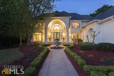 This elegant home radiates warmth with many transitional spaces.