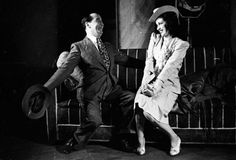 London, 1941: Sitting on a couch, Stanley Lupino (1896 - 1942) as Tony Meyrick woos Patricia Kirkwood as Bonnie Drew in a scene f rom 'Lady Behave' at His Majesty's' Theatre, London. Original Publication: Picture Post - 820 - Lady Behave - unpub. (Photo by Bert Hardy/Picture Post/Getty Images)