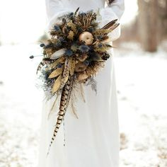 Add feathers to your bouquet for a rustic boho feel.