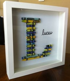 Great DIY idea for nursery decor with crayons in a shadowbox frame one for both boys rooms