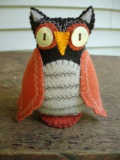 felt owl decoration, $25, Just black orange and yellow.  The cream.. nah.  Black wings, orange belly.