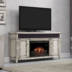 The Simmons Electric Fireplace Entertainment Center in Country White - 26MMS8529-T478 is a large cabinet that mixes rustic charm with modern technology. Featuring a beautiful Country White finish that...