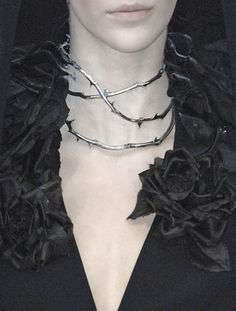 Alexander McQueen Spring 2007 Details.  Just love the contrast of thorn necklace against black rose collar....