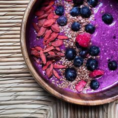 Chia oat Pitaya raw vegan breakfast smoothie bowl with flax seed, goji berries, blueberries and raspberries.