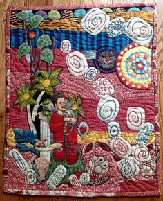 """One of two small quilts featuring Frida Kahlo de Rivera (1907-1954), Mexican Artist.  Measures 16"""" by 20"""".  Machine pieced background, machine and hand appliqué, hand embroidery, and hand quilted.  Finished May 15, 2013.  Now at Short Term Gallery, Baker City, Oregon.  Posted by Powder River Threadworks."""