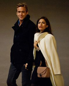 Ryan Gosling and Eva Mendes take a romantic walk to see the Eiffel Tower
