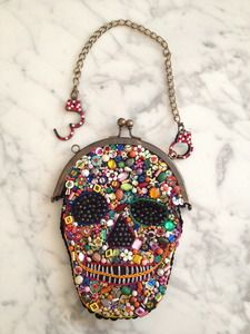 """The only one in existence! """"Dia de los Muertoz"""" Beaded Skull Evening Bag *ONE-OF-A-KIND* Vintage beaded bag (purchased at an antique market in São Paulo while Linz was traveling in Brazil) adorned with CUFFZ' signature authentic Swarovski paveed miniature working handcuffs. The front of the bag is decked out with a thick beaded mosaic scull (embroidery and assorted bead & sequin shapes)"""