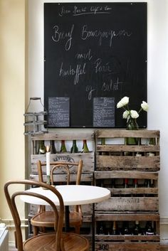 Café Tabletops: Wooden Chairs, Plastic Top | This cafe has a really rustic feel to it. This is emphasised with the tables by using old wooden chairs and pairing it with a plastic tabletop. Plastic is suitable as a tabletop in this setting as it is easy to clean and inexpensive.