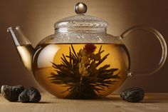 Pu-erh tea is loose-leaf blends from China. If you're looking for a hint of sweetness, check out the rose-infused, loose-leaf blends in the online store. Restaurants Gastronomiques, Tea Wallpaper, Tea Display, Pu Erh Tea, Glass Teapot, Oolong Tea, Flower Tea, Lotus Flower, Chinese Tea
