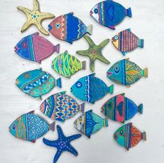 Fish Wall Art Painted Sign Beach House Decor Coastal Nautical Decor by CastawaysHall ONE Large Fish The colourful hand painted art fish, new to CastawaysHall. Their bright colours and details will add Beach House Style to any space. Display just one or a whole school. Each one is also clear coated so that you can also use them outside. Each one comes ready to hang. This listing price is for the ONE fish shown in the individual picture only. Other fish shown in the school as well as small…