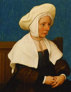 Portrait of a Woman, c. 1532-35, Holbein.  A front fastening gown with trim with fur lining. Linen shawl pinned on. Linen cap and wool hat.