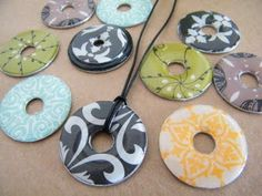 DIY washer necklace - great tutorial for how to cover washers and give them the glossy raised look.>>the girls would love these. Fun!!!