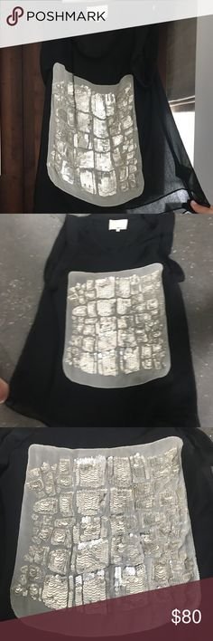 3.1 Phillip Lim Black Blouse 3.1 Phillip Lim black and silver sleeveless top with crew neck, sequin embellished panel at front and cuffed sleeves. 3.1 Phillip Lim Tops Tees - Short Sleeve