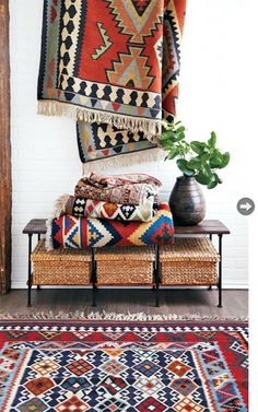 (BrandonRugs.com) Brightly colored geometric rugs (including kilims and soumaks) can be used on the wall in lieu of other kinds of abstract art -- and at considerable savings versus paintings.
