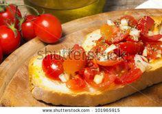 italian bruschetta with oil, garlic and tomato by Donatella Tandelli, via Shutterstock