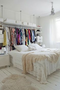 Clothes-collector? Consider expanding your closet with built-in (or free standing) shelves and rods. If you don't want all of your threads displayed constantly, add a curtain in front to keep your walk-in closet accessible but invisible.