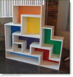 giggles...Tetris shelf! ...Perfect for storing all of your board games, card games, hand-held electronic games, etc.