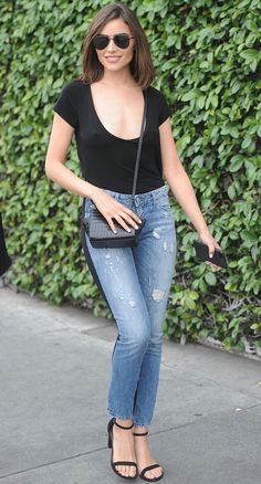 See why Olivia Culpo's skinny jeans will make you do a double take. Plus, shop her latest denim look.