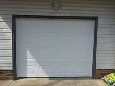 A beautiful garage door - white, short panel, no windows. Great and affordable way to add curb appeal to your home.