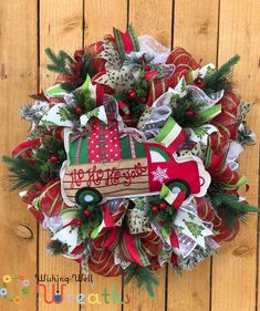 This Mesh Christmas Red Truck Wreath is perfect for any country or farmhouse styled home. THis red truck Christmas Wreath comes with a sign shaped as a red truck pillow carrying various presents and packages in his bed. THis Wreath is made out of red and lime green mesh and is full of beautiful ribbons in red and green, one print includes a green Christmas tree these ribbons match perfectly with the ornaments which include big fluffy snowballs, pinecones and red berries!