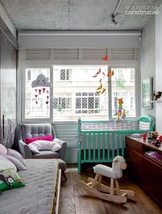 http://casa.abril.com.br/materia/home-theater-virou-quarto-de-bebe-neste-apartamento?utm_source=redesabril_casas&utm_medium=facebook&utm_campaign=redesabril_revistaaec