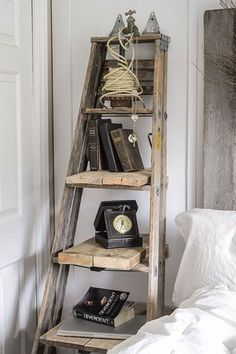 To add a bedside storage table and shelf in a tight space, Donna, of Funky Junk . To add a bedside storage table and shelf in a tight space, Donna, of Funky Junk Interiors beefed up an old ladder with salvaged boards for shelves and wall supports. Funky Junk Interiors, Rustic Furniture, Diy Furniture, Furniture Projects, Furniture Plans, System Furniture, Furniture Cleaning, Furniture Chairs, Furniture Vintage
