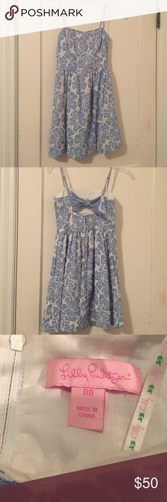 Lilly Pulitzer sand dollar print baby doll dress This dress was worn once, is fitted at the chest and has a back with a bow detail. Sky blue sand dollar print has small eyelet details and dress is fully lined with adjustable spaghetti straps. Ends just above the knee! Lilly Pulitzer Dresses Mini