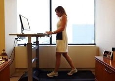 Mary Rust uses the treadmill desk in her office at Taft Stettinius and Hollister LLP's Private Client Group. The law firm has treadmills to help employees who work at their desks a lot to continue their efforts to stay fit.