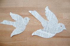 Paper bird cutouts from old dictionarys