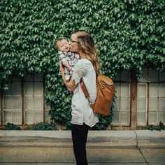 A minimalist faux leather diaper bag backpack; Sparing nothing in quality, this sleek faux leather bag is modern, understated, and highly functional. Best Diaper Bag, Diaper Bag Backpack, Leather Diaper Bags, Family Album, Baby Family, Traveling With Baby, Baby Fever, Girl Photos, Little Ones