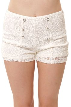 Nautical style shorts are always popular! The Dolly Shorts by Potter's Pot take nautical and give them a delicate twist. These lace high waist shorts lace shorts have traditional front button detail,
