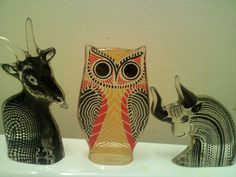 Two of the head figures, Goat and Minotaur, flank a pretty Orange Owl.