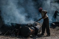 Indian worker covered in smoke preparing tar for a road building in Manali, India.   art / boho / asian / photo / print / wall decor / low key / black  https://www.etsy.com/listing/216929119/indian-worker-covered-in-smoke-preparing