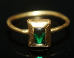 14th Century  gold finger ring  with a cabochon green glass setting.