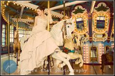 Carnival theme wedding, carousel bride, fun wedding... because who wouldn't want a carousel at their wedding? Right?